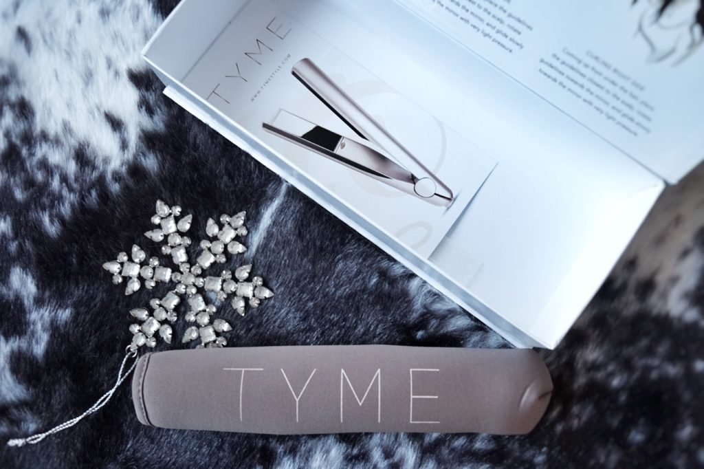 Calgary based blog by Drea Marie shares her fav holiday hair style. The TYME iron has changed her hair game.